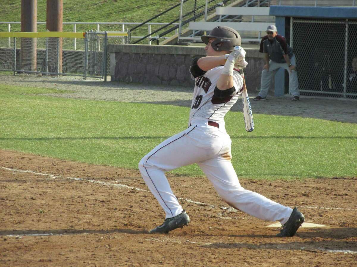 Torrington's Cam Cerruto homered and tripled for his second straight game in a losing effort against Woodland Tuesday afternoon at Torrington's Fuessenich Park.