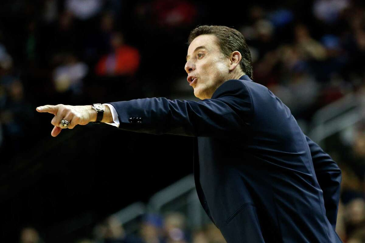 SEATTLE, WA - MARCH 22: Head coach Rick Pitino of the Louisville Cardinals signals in the first half of the game against the Northern Iowa Panthers during the third round of the 2015 NCAA Men's Basketball Tournament at KeyArena on March 22, 2015 in Seattle, Washington. (Photo by Ezra Shaw/Getty Images) ORG XMIT: 527066155
