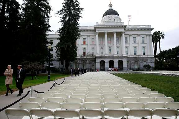 A sea of empty chairs are displayed on the north lawn of the State Capitol where Gov. Jerry Brown presented highlights of his proposed $131.7 billion budget for 2018-19 in Sacramento, Calif. on Wednesday, Jan. 10, 2018. The 1,570 chairs, each representing 20 students who, according to the California Faculity Association and who arranged the installation, have been denied admission to the California State University system despite having the grades eligible for acceptance.