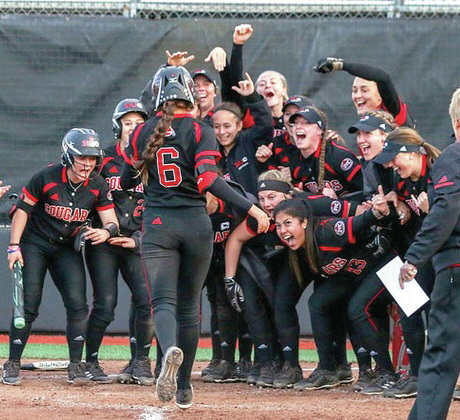 SIUE's Alana Cobb-Adams (6) is greeted by her teammates at home plate after homering in the fifth inning of the second game in Tuesday's doubleheader sweep over Eastern Illinois University. Photo:     SIUE Athletics