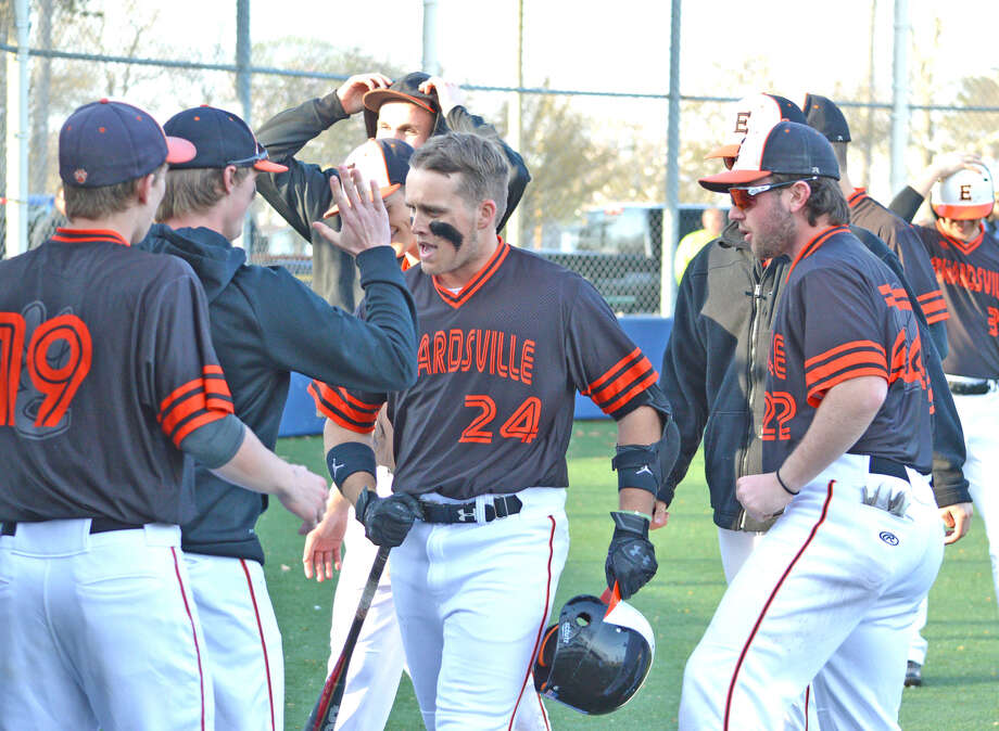 Edwardsville senior Reid Hendrickson, middle, is congratulated by his teammates after hitting a game-tying two-run homer in the top of the sixth inning on Tuesday at O'Fallon.