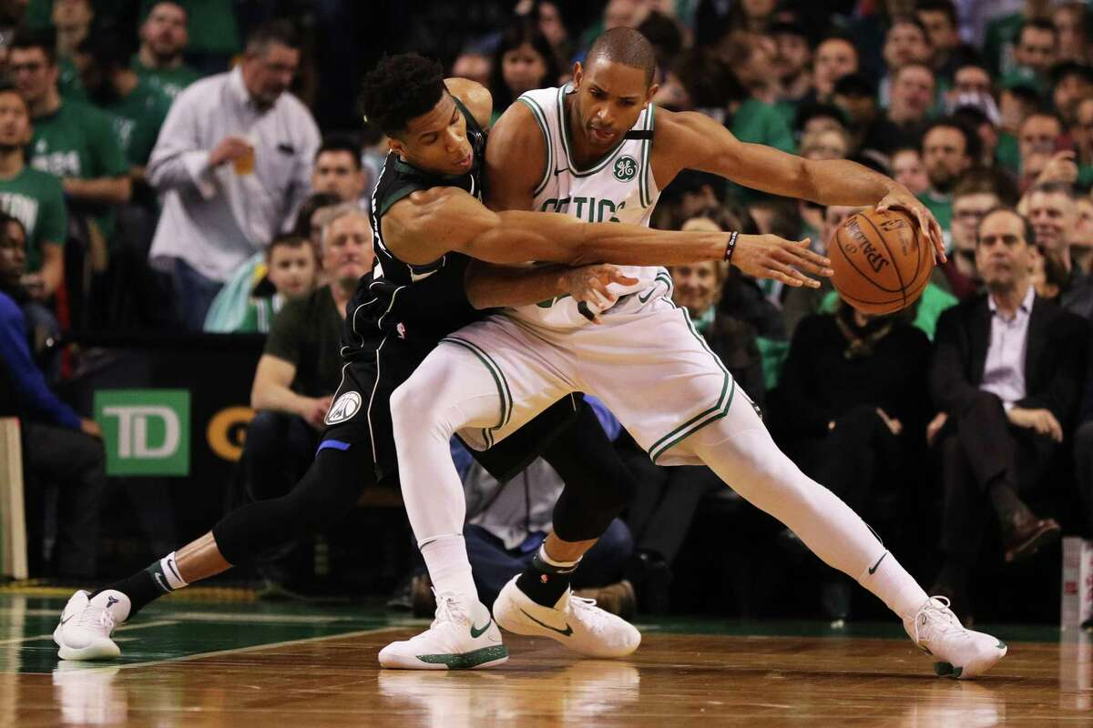 BOSTON, MA - APRIL 17: Giannis Antetokounmpo #34 of the Milwaukee Bucks defends Al Horford #42 of the Boston Celtics in the first quarter of Game Two in Round One of the 2018 NBA Playoffs at TD Garden on April 17, 2018 in Boston, Massachusetts. (Photo by Maddie Meyer/Getty Images)