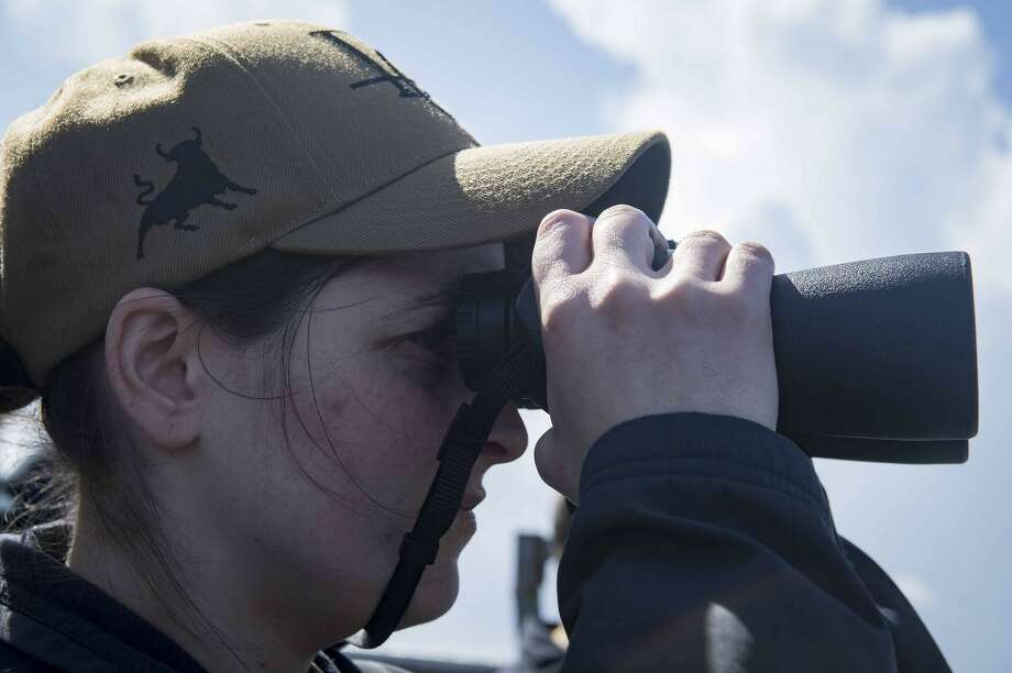 Ensign Rachel Berger of Sherman graduated from the United States Naval Academy in 2016. Above, she looks through binoculars aboard the Arleigh Burke-class guided-missile destroyer USS Donald Cook (DDG 75) in late March. Donald Cook, forward-deployed to Rota, Spain, is on its seventh patrol in the U.S. 6th Fleet area of operations in support of regional allies and partners, and U.S. national security interests in Europe and Africa. Photo: Courtesy Of U.S. Navy Photo By Mass Communication Specialist 2nd Class Alyssa Weeks / The News-Times Contributed