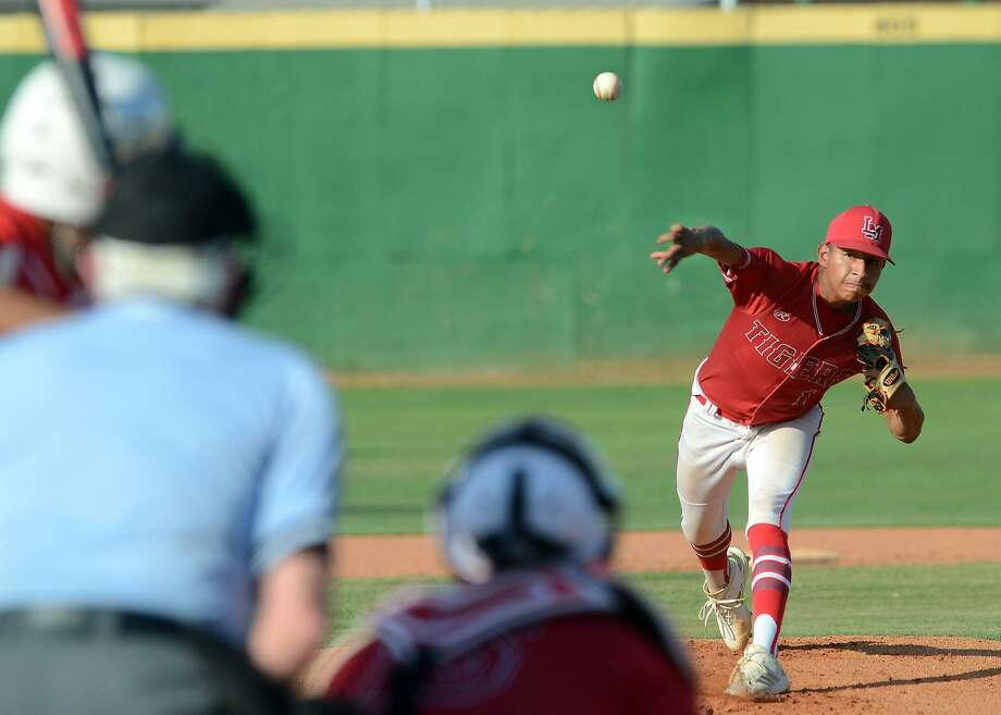 Kenny Salas pitched a complete game for 12 strikeouts and was 4-for-4 at-bat in Martin's (15-10, 7-5 District 31-5A) 10-2 victory over the Roma Gladiators Tuesday night. Photo: Cuate Santos /Laredo Morning Times / Laredo Morning Times