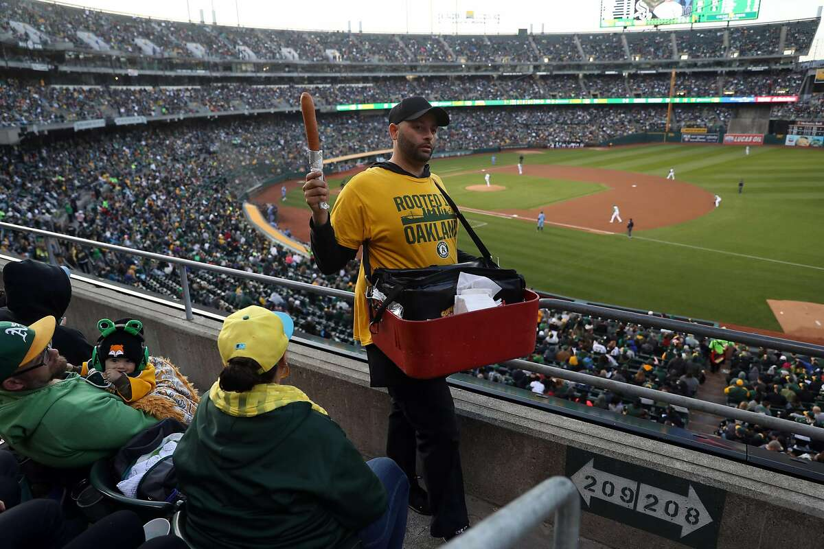 A vendor sells corn dogs during Oakland Athletics' 50th anniversary game at Oakland Coliseum in Oakland, Calif., on Tuesday, April 17, 2018.