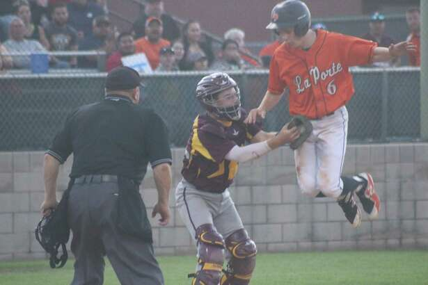Deer Park catcher Tyler Weir applies the dramatic tag on La Porte's Kacey McCoy as McCoy was trying to get the Bulldogs on the board in the third inning. The play was the result of a strong throw from right fielder Jordan Phillips.