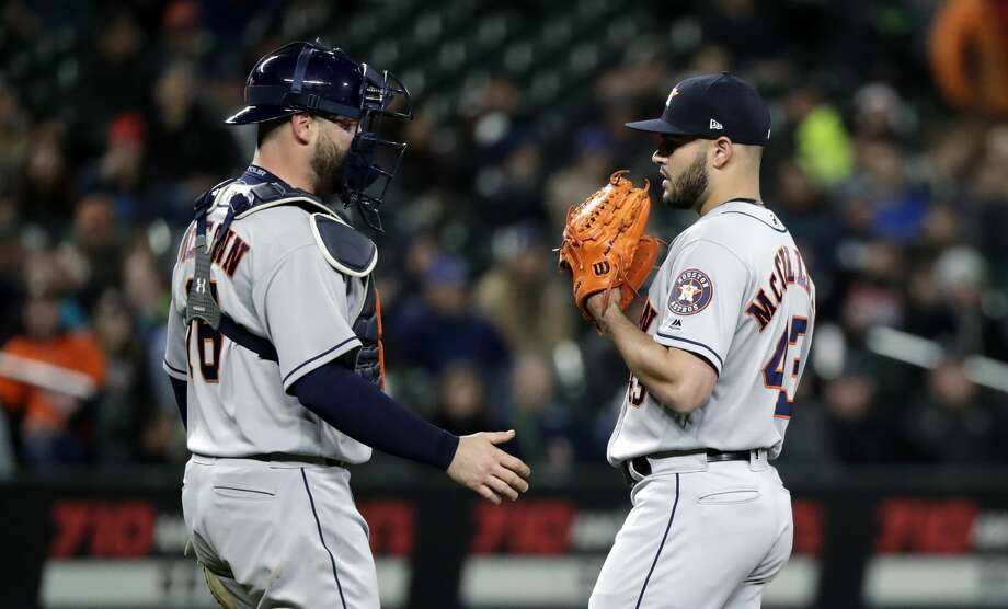 Houston Astros starting pitcher Lance McCullers Jr., right, chats with catcher Brian McCann during a baseball game against the Seattle Mariners Tuesday, April 17, 2018, in Seattle. (AP Photo/Elaine Thompson) Photo: Elaine Thompson/Associated Press