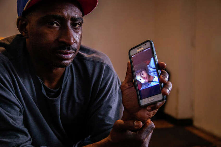 Tarrano Murry shows pictures of his daughter Nasjay Murry, a graduate of King College Prep in Chicago and student at Bradley University in Peoria who was shot to death during a party near the campus. Nasjay Murry's funeral will be this weekend. Photo:       Zbigniew Bzdak   Chicago Tribune (AP)