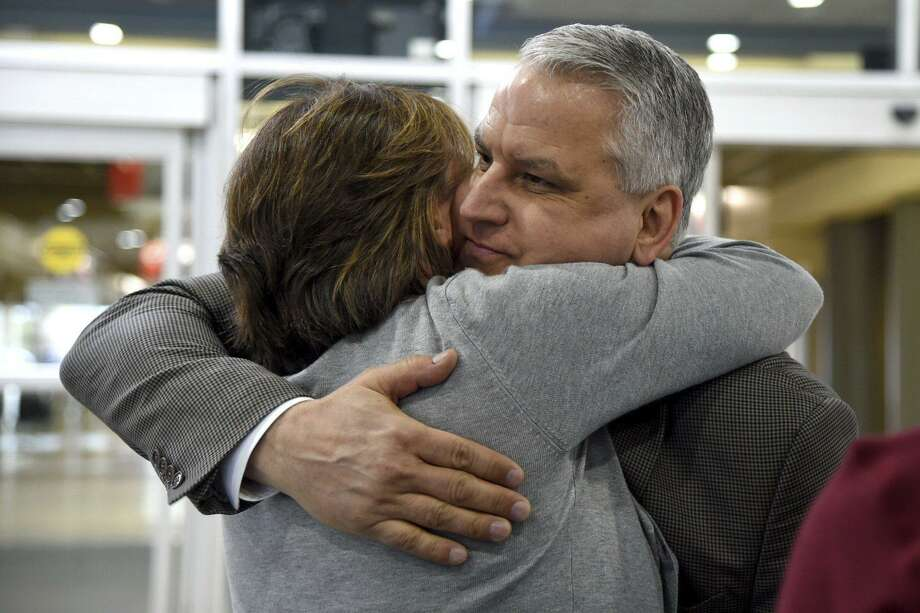 Jim Demetros, of Stamford, Conn. hugs his wife Cindy as she arrives from their home in Connecticut to pick him at Philadelphia International Airport, Tuesday, April 17, 2018, after his Southwest Airlines plane landed with a damaged engine. The Southwest Airlines jet apparently blew an engine at about 30,000 feet and got hit by shrapnel that smashed a window and damaged the fuselage Tuesday, killing a passenger and injuring seven others, authorities said. Photo: Tom Gralish / AP / The Philadelphia Inquirer