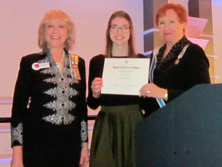 Hannah Bartels, center,receivesa certificate from State Good Citizens Chair Christine Richman and State Regent Diane Schrift. (Photo provided)