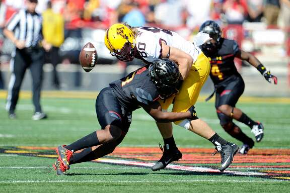 COLLEGE PARK, MD - OCTOBER 15:  Jermaine Carter Jr. #23 of the Maryland Terrapins forces a fumble on Nate Wozniak #80 of the Minnesota Golden Gophers on October 15, 2016 in College Park, Maryland.  (Photo by G Fiume/Maryland Terrapins/Getty Images)