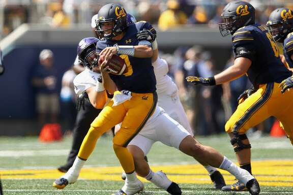BERKELEY, CA - SEPTEMBER 09:  Ross Bowers #3 of the California Golden Bears is tackled by McKay Murphy #90 of the Weber State Wildcats at California Memorial Stadium on September 9, 2017 in Berkeley, California.  (Photo by Ezra Shaw/Getty Images)