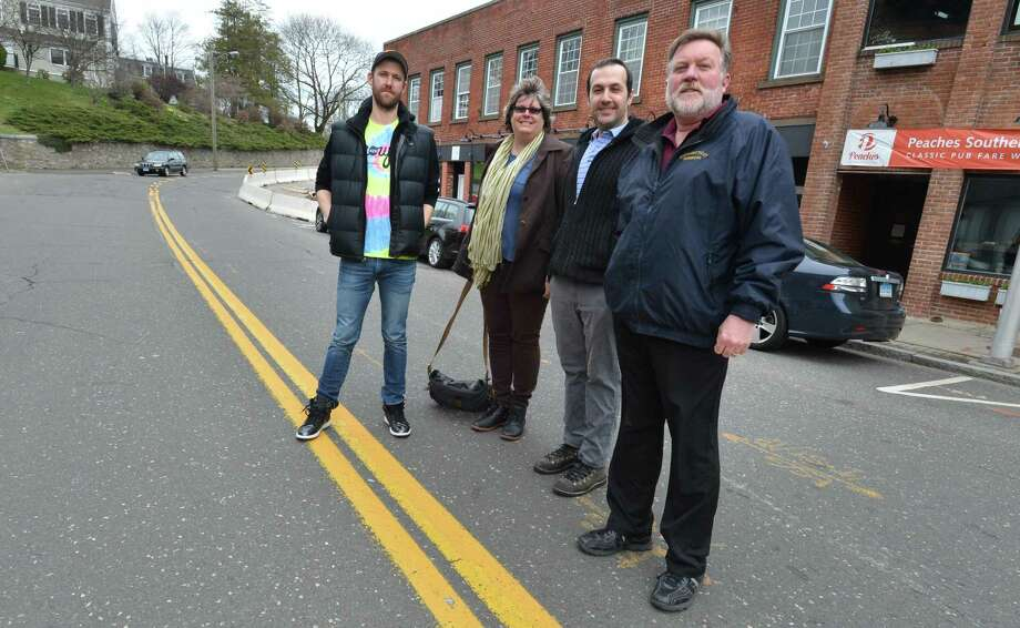 Local business owners Casey Fitzpatrick, Jackie Lightfield, Melkon Vartanian and Douglas Fraser stand on East Wall St. at Knight St. on Tuesday April 17, 2018 in Norwalk Conn.where they are asking for the Norwalk Traffic Authority to approve a crosswalk at the intersection, as well as along East Avenue at St. Paul's Place, to help pedestrians cross safely. Photo: Alex Von Kleydorff / Hearst Connecticut Media / Norwalk Hour