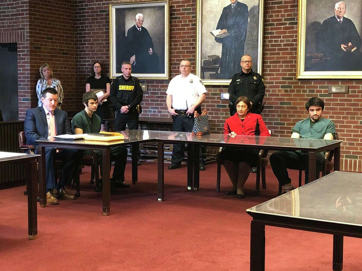 Convicted killers Joseph Broscko, left in green jumpsuit, and Nikolai Mavashev, at right in green jumpsuit sit with their lawyers, Mattherw Chauvin and Cheryl Coleman, respectively, as they await sentencing for the killing last year of David Feliciano.