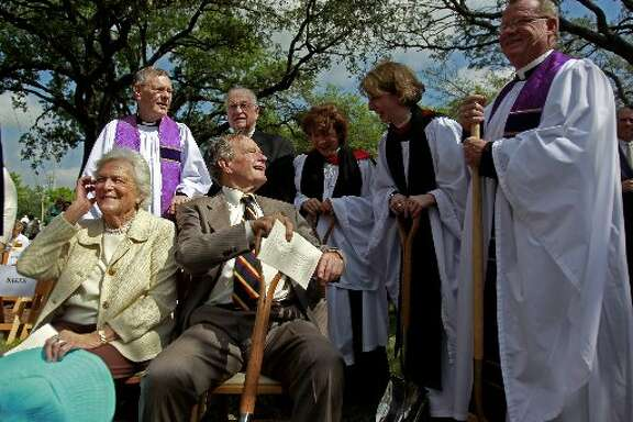 President George H.W. Bush and his wife Barbara Bush are greeted by a group of St. Martin's clergy after a ceremonial groundbreaking event for The Hope and Healing Center at St. Martin's Episcopal Church Sunday, April 10, 2011, in Houston.