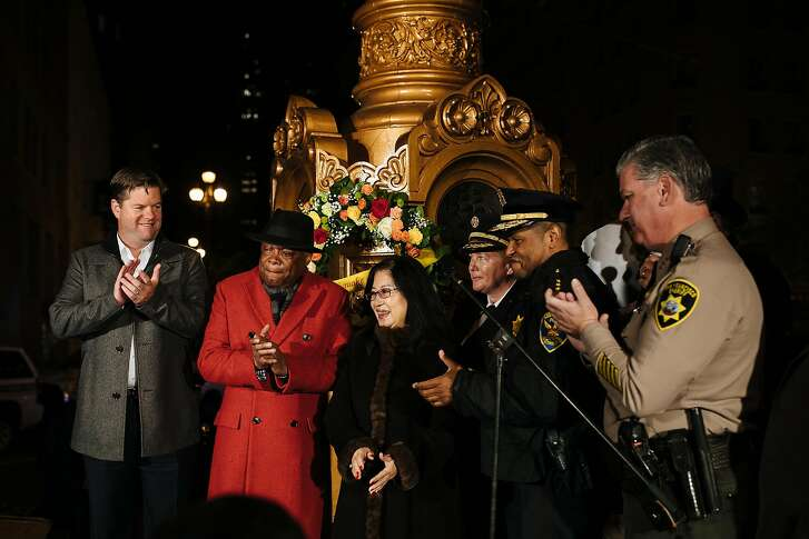 City officials and former Mayor Ed Lee's wife, Anita Lee, center, stand in commemoration to the 112th anniversary of the 1906 earthquake and fire at the Lotta's Fountain In San Francisco, Calif., Tuesday, April 17, 2018.