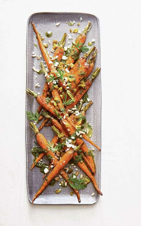 "Baby Carrots with Carrot-Top Pesto from ""Saladish"" by Ilene Rosen. Photo: Courtesy Joseph De Leo /Artisan Books"