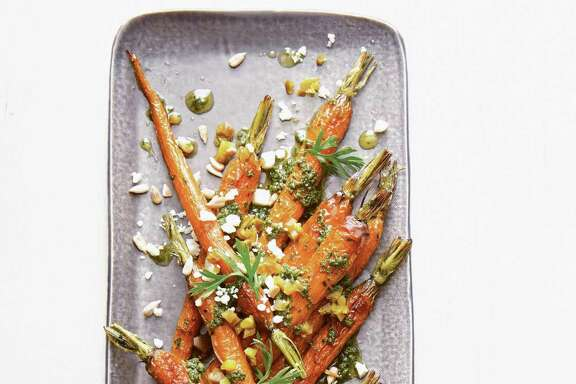 "Baby Carrots with Carrot-Top Pesto from ""Saladish"" by Ilene Rosen."