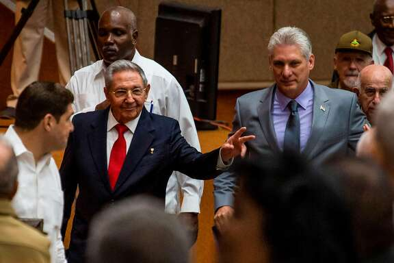 """Handout picture released by Cuban official website www.cubadebate.cu showing Cuban President Raul Castro (L) and First Vice-President Miguel Diaz-Canel (C) arriving for a National Assembly session that named the latter as the candidate to succeed Castro as president, in Havana on April 18, 2018. Miguel Diaz-Canel is the sole candidate to succeed Cuba's President Raul Castro, officials announced Wednesday on the eve of a vote in the National Assembly. Diaz-Canel, a 57-year-old Communist Party official and the country's current first vice president, is due to be confirmed on Thursday as the successor to Castro, whose departure will end his family's six-decade grip on power.  / AFP PHOTO / www.cubadebate.cu / HO / RESTRICTED TO EDITORIAL USE - MANDATORY CREDIT """"AFP PHOTO / www.cubadebate.cu"""" - NO MARKETING NO ADVERTISING CAMPAIGNS - DISTRIBUTED AS A SERVICE TO CLIENTS  HO/AFP/Getty Images"""