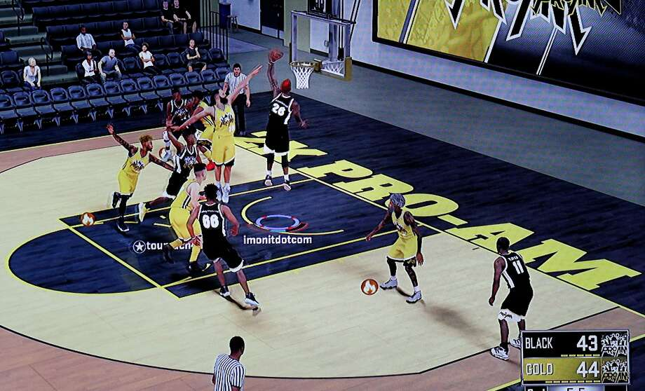 """In Hayward, Sabrina Patton controls her """"NBA 2K18"""" player (26). She hoped to be drafted by the Warriors in the e-sports league but ultimately fell short. Photo: Michael Macor / The Chronicle"""