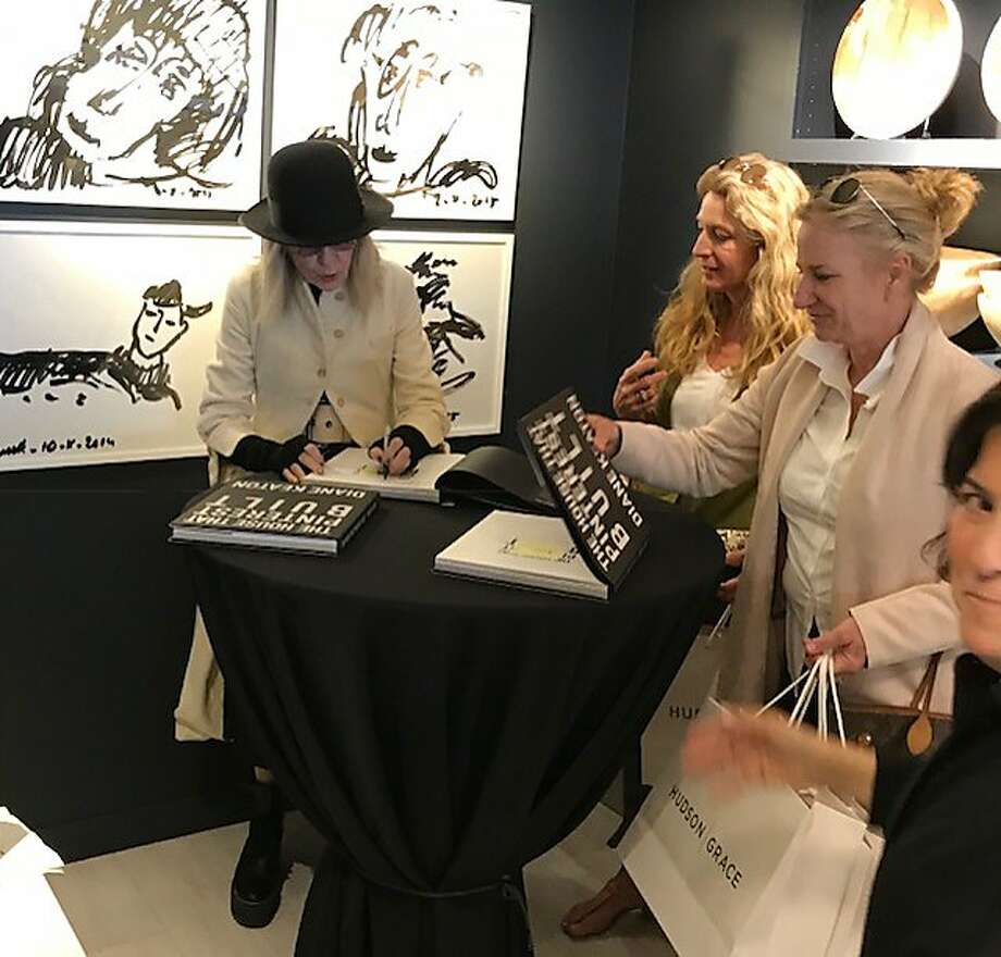 Diane Keaton talks with some fans at the book event at Hudson/Grace. Photo: Leah Garchik / The Chronicle