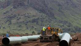 A crew works Tuesday August 30, 2016 on a 42-inch natural gas pipeline near Alpine, Texas, which extends to just 12 miles upriver on the Rio Grande from Presideo, Texas. The Trump administration wants to make several changes to the North American Free Trade Agreement that could unwittingly stall U.S. energy investments in Mexico and force consumers south of the border to turn to other suppliers like China and Russia.