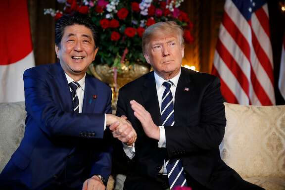 FILE - In this April 17, 2018 file photo, President Donald Trump and Japanese Prime Minister Shinzo Abe speak during a meeting at Trump's private Mar-a-Lago club, in Palm Beach, Fla. Japan has reported that its trade surplus with the U.S. grew nearly 6 percent in the fiscal year through March, 2018. The trade figures were released Wednesday, April 18, 2018,  as Prime Minister Shinzo Abe was in the U.S. for meetings with President Donald Trump, who has complained repeatedly about the trade imbalance with Japan. (AP Photo/Pablo Martinez Monsivais, File)