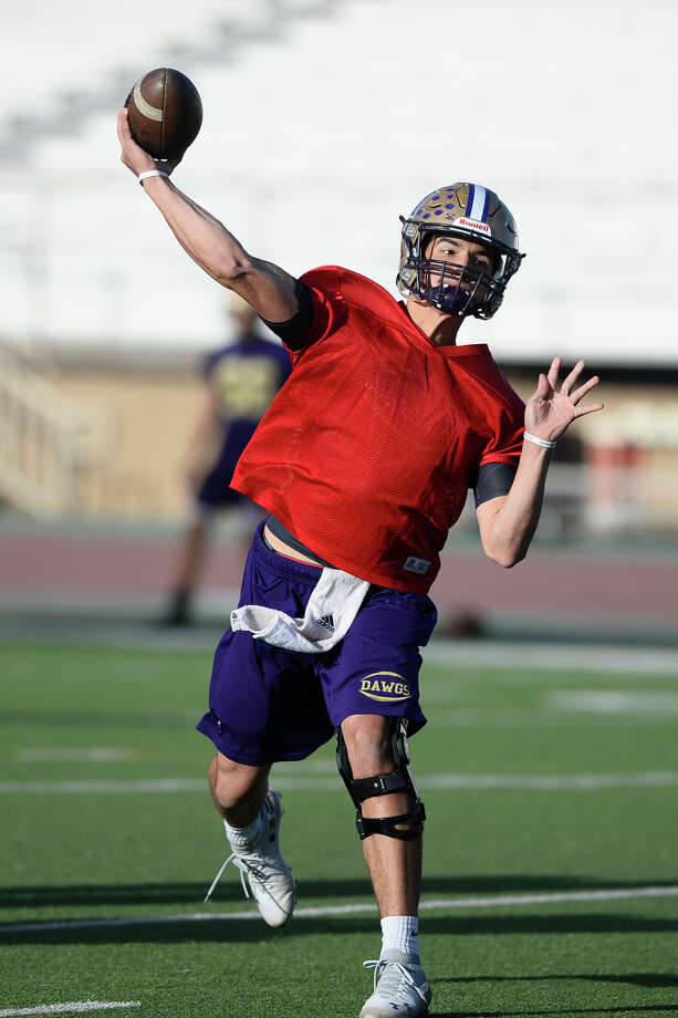 Midland High quarterback Suddin Sapien throws a pass on the first day of spring practice April 18, 2018, at Memorial Stadium. James Durbin/Reporter-Telegram Photo: James Durbin
