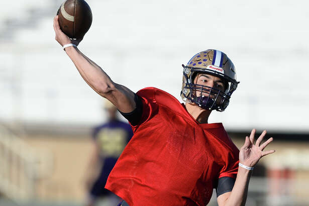 Midland High quarterback Suddin Sapien throws a pass on the first day of spring practice April 18, 2018, at Memorial Stadium. James Durbin/Reporter-Telegram