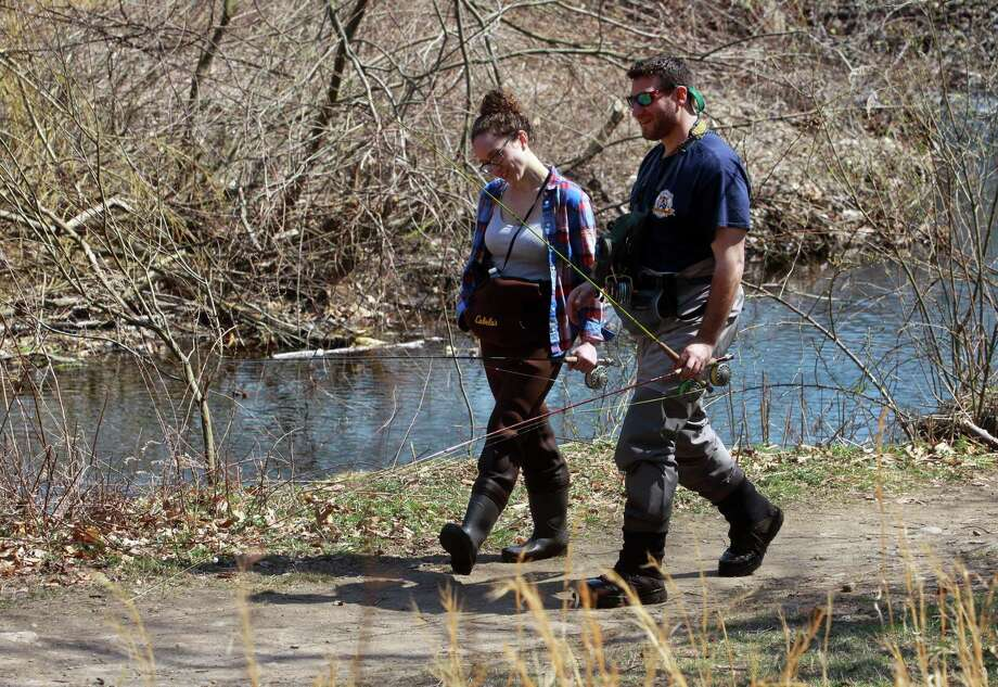 Lauren Sordellini and Gordon Kempler, both of Stamford, take a break to go have lunch during opening day of fishing season at Mill River in Fairfield, Conn., on Saturday Apr. 14, 2018. Photo: Christian Abraham / Hearst Connecticut Media / Connecticut Post