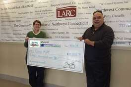 Katherine Marchand-Beyer of LARC and Emil Renzullo of the Miles for Moe Fund accept a $15,000 donationfrom theNorthwest Connecticut Community Foundation.