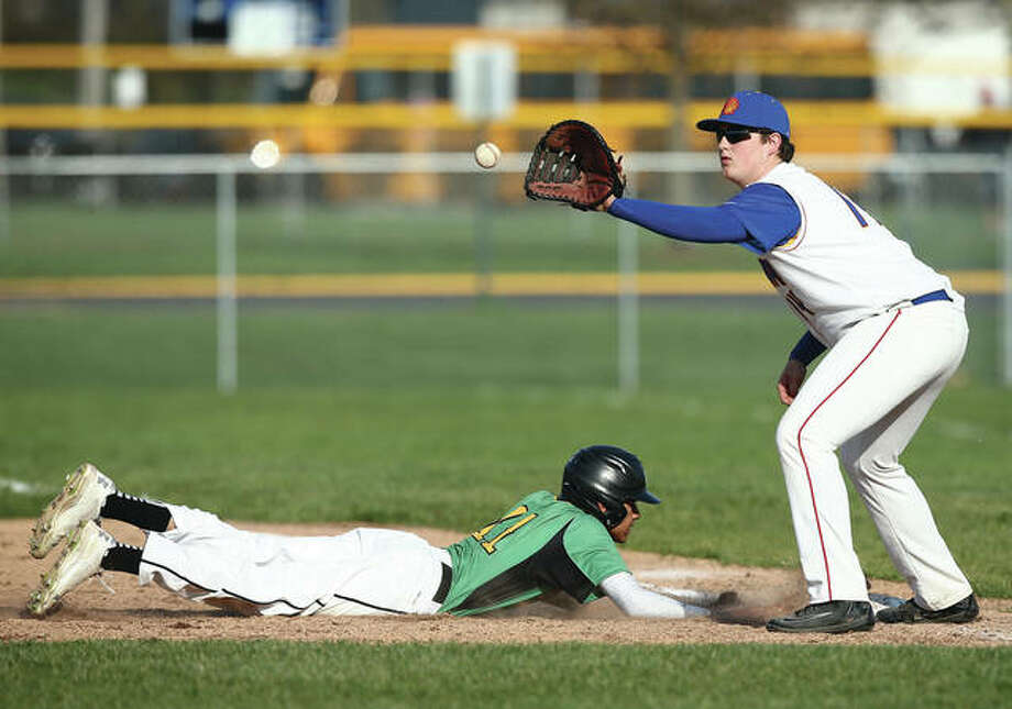Roxana first baseman Will Moore (right) takes the pickoff throw while Southwestern's Jack Little dives safely back to thte bag during a South Central Conference baseball game Tuesday after noon in Roxana. The Shells will be back home Thursday to play rival East Alton-Wood River in a game that will include a ceremony dedicated the renovated field. Photo:       Billy Hurst / For The Telegraph