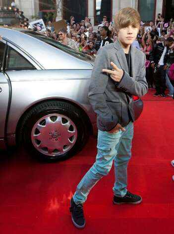 Justin Bieber poses for a photograph on the red carpet at the MuchMusic Video Awards in Toronto, Sunday June 20, 2010. (AP Photo/The Canadian Press, Nathan Denette) Photo: Nathan Denette