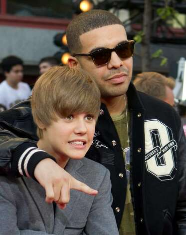 Justin Bieber and Drake, right, pose for a photograph on the red carpet at the MuchMusic Video Awards in Toronto, Sunday June 20, 2010. (AP Photo/The Canadian Press, Darren Calabrese) Photo: Darren Calabrese