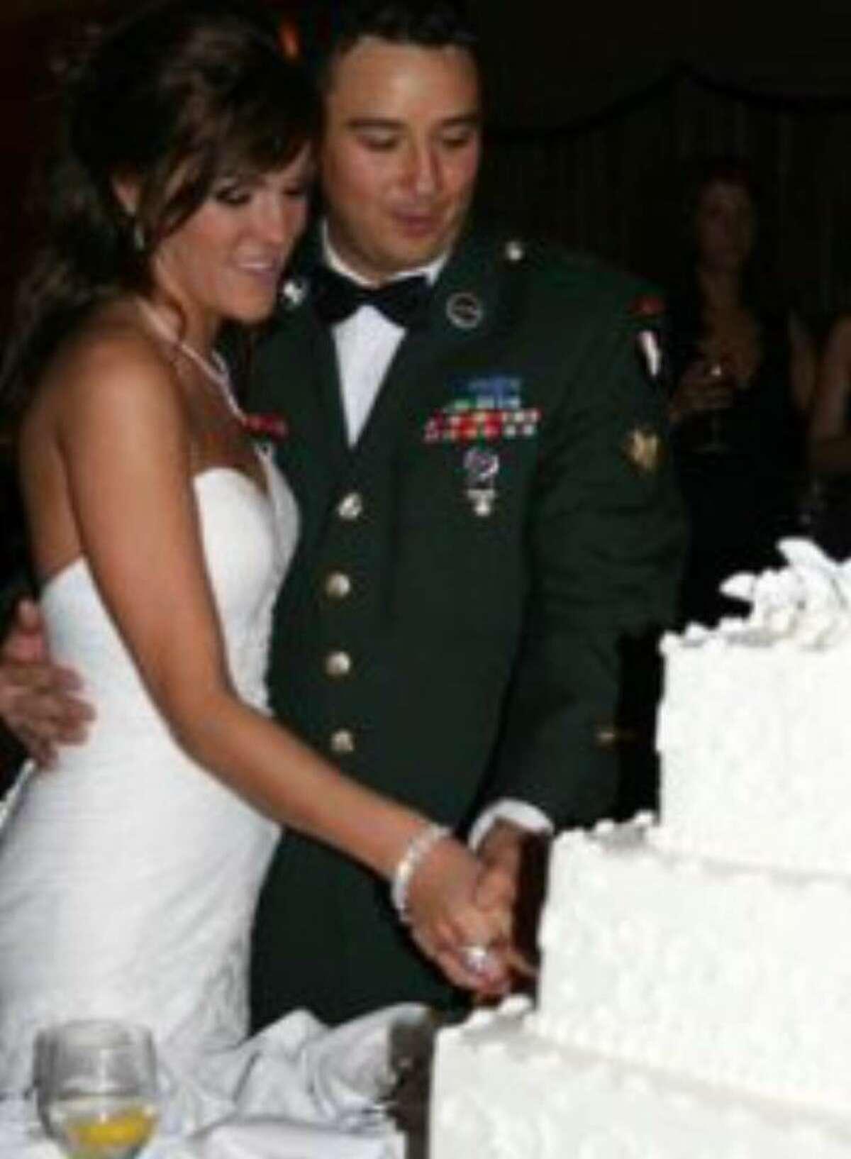 Spc. Benjamin D. Osborn and his wife, Nicole Lapier- Osborn, on their wedding day in February.