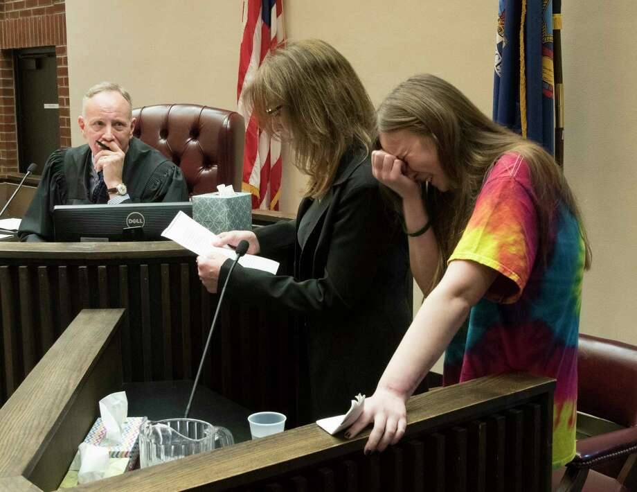 Bonnie Jones, mother of murder victim David Feliciano reads her victim impact statement as Feliciano's girlfriend Nadine Doyle, right,  breaks down as Judge James Murphy, left looks on before sentencing convicted murderers Joseph Broscko and Nikolai Mavashev, Wednesday April 18, 2018  in Saratoga County Court in Ballston Spa, N.Y.  (Skip Dickstein/Times Union) Photo: SKIP DICKSTEIN, Albany Times Union / 40043548A