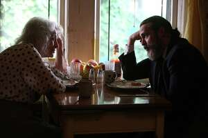 """Joe (Joaquin Phoenix, right) takes care of his mother (Judith Roberts) in Lynne Ramsay's """"You Were Never Really Here."""""""