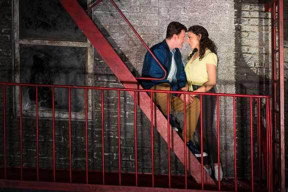 "Andrea Carroll as Maria and Norman Reinhardt as Tony in the Houston Grand Opera's production of ""West Side Story."""