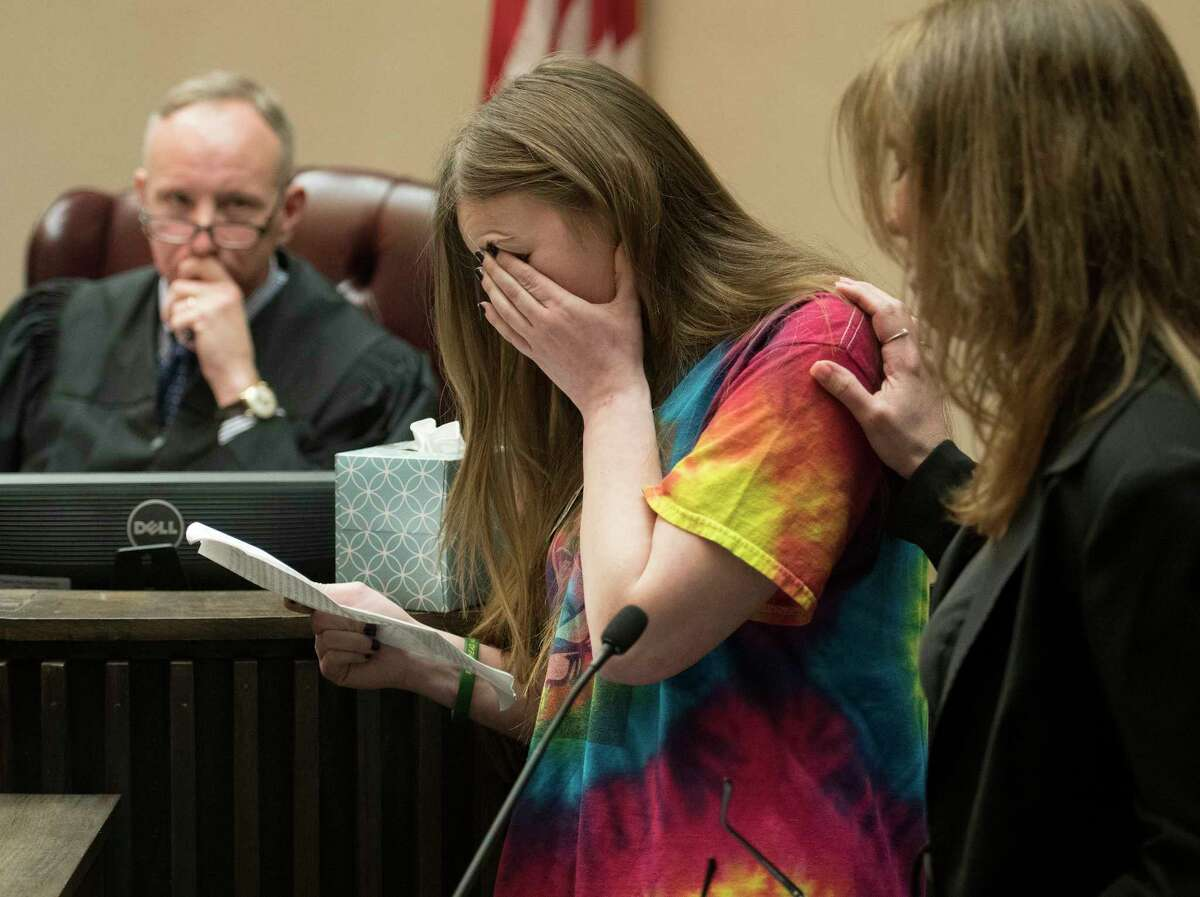 Bonnie Jones, right, mother of murder victim David Feliciano listens as Feliciano's girlfriend Nadine Doyle breaks down while she reads her victim impact statement as Judge James Murphy, left looks on before sentencing convicted murderers Joseph Broscko and Nikolai Mavashev, Wednesday April 18, 2018 in Saratoga County Court in Ballston Spa, N.Y. (Skip Dickstein/Times Union)