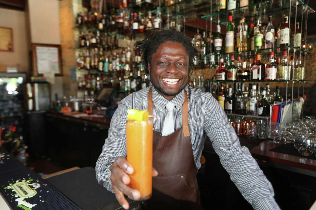 Etoile's Bartender Mike Danner serves up a drink Wednesday, April 4, 2018, in Houston. ( Steve Gonzales / Houston Chronicle )