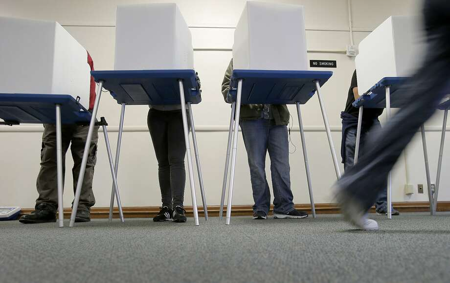 Voters fill out their ballots in Oakland in 2014. Photo: Brant Ward / The Chronicle