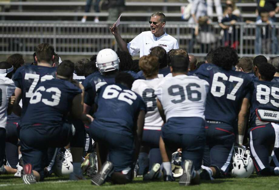 UConn coach Randy Edsall talks with his team at the end of the Huskies' spring game on Saturday in East Hartford. Photo: Jessica Hill / Associated Press / AP2018