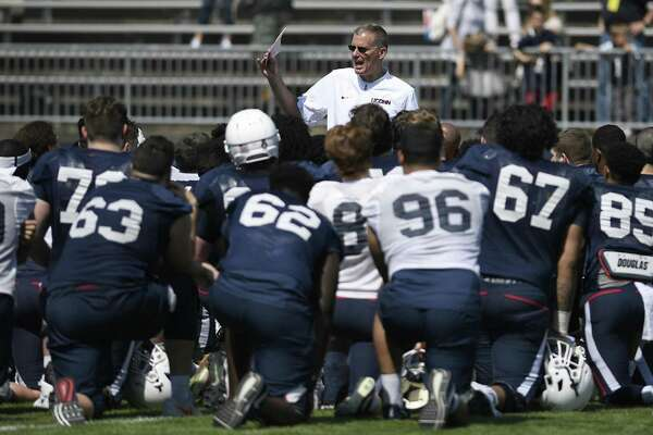 UConn coach Randy Edsall talks with his team at the end of the Huskies' spring game on Saturday in East Hartford.