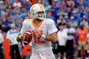 FILE - In this Sept. 16, 2017, file photo, Tennessee quarterback Quinten Dormady plays against Florida during an NCAA college football game in Gainesville, Fla. Dormady said on Instagram that he's transferring to Houston. (AP Photo/John Raoux, File)