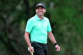 FILE - In this March 24, 2018, file photo, Sergio Garcia smiles as he prepares to putt on the first green during round four at the Dell Technologies Match Play golf tournament,  in Austin, Texas. Sergio Garcia has a long history with Texas even before he became a part-time resident. Now, the connection extends to family. He married Angela Akins last summer, and he's based out of the Austin area when he's playing in America. Garcia also has a connection to the Valero Texas Open, where he is expected to play this week in San Antonio. (AP Photo/Eric Gay, File)