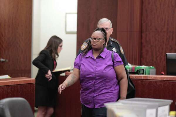 Crenshanda Williams, 43, of Houston, is facing two misdemeanor charges for allegedly hanging up on concerned callers  appears in court  Oct. 17,2016, in Channelview. ( James Nielsen / Houston Chronicle )