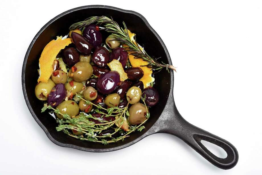 Olives in a pan on Friday, April 13, 2018, at the Times Union in Colonie N.Y.  (Will Waldron/Times Union) Photo: Will Waldron / 20043493A