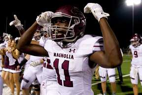 Magnolia running back Darren Battle (11) celebrates after defeating Magnolia West 21-14 during a District 20-5A high school football game at Mustang Stadium Friday, Oct. 14, 2016, in Magnolia. Battle scored the go-ahead touchdown with a 37-yard run.