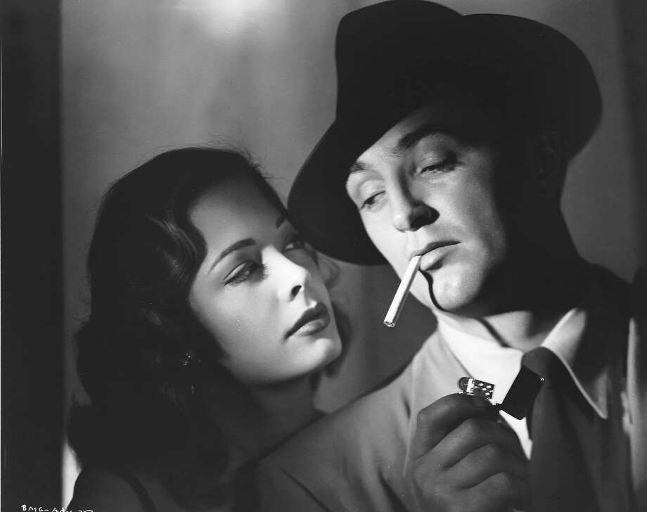 """This undated publicity photo, provided by Warner Home Video, shows actors Jane Greer and Robert Mitchum in the 1947 noir movie """"Out of the Past,"""" which was released on DVD, part of a boxed set, in 2004. (AP Photo/Warner Home Video) Ran on: 08-28-2006 Jane Greer and Robert Mitchum in &quo;Out of the Past,&quo; which was released on DVD in 2004. Photo: Warner Home Video), AP"""