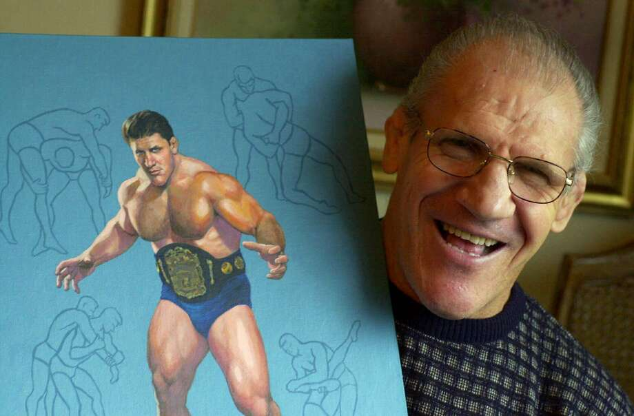 Former pro wrestler Bruno Sammartino, 65, poses with a painting of him in his prime weighing 275 pounds in 1965 at age 35, in his Pittsburgh home. Photo: Gene J. Puskar / Associated Press 2000
